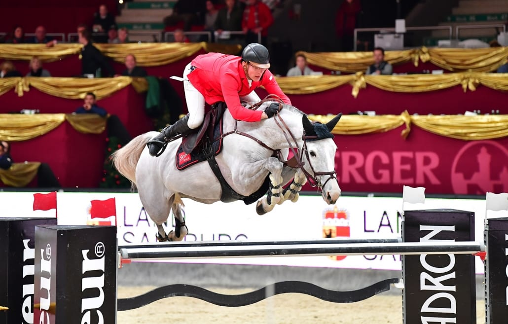 Top in Form! Tobias Meyer und seine Oldenburger Stute Queentina sprangen souverän zum Sieg im Sportland Salzburg Grand Prix presented by MUKI bei der Amadeus Horse Indoors 2018. © im|press|ions - Daniel Kaiser